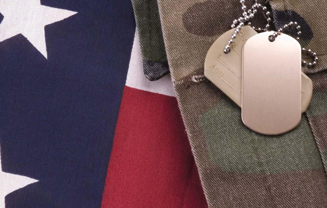 American flag, dog tags and camo