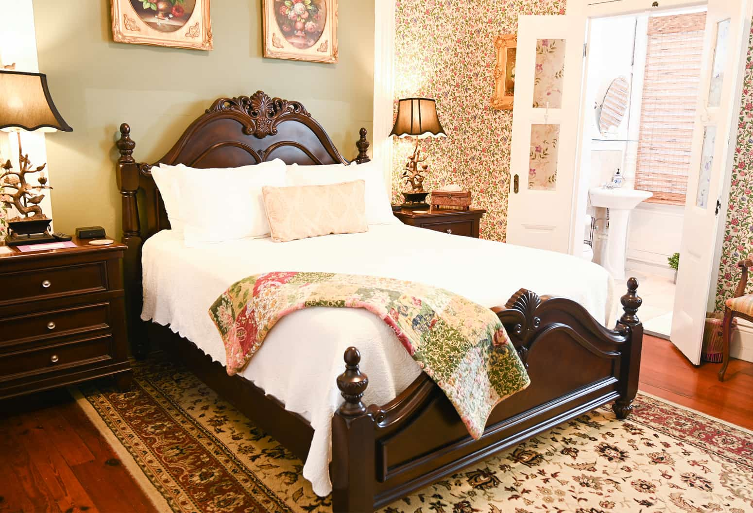 wood bed in romantic guest room in Key West